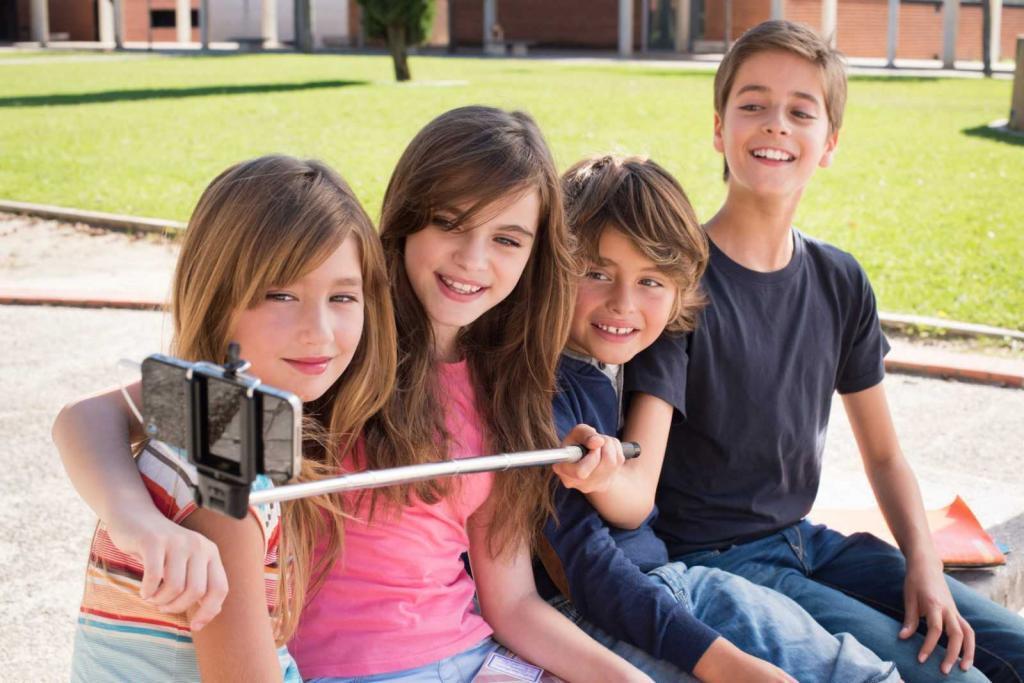 School kids talking photos with a selfie stick